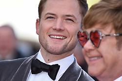 """Elton John, Taron Egerton attend the screening of """"Rocket Man"""" during the 72nd annual Cannes Film Festival on May 16, 2019 in Cannes, France. Photo by Lionel Hahn/ABACAPRESS.COM"""