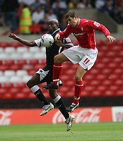 Photo: Pete Lorence.<br />Nottingham Forest v Swansea City. Coca Cola League 1. 30/09/2006.<br />Ezomo Iriekpen and Grant Holt in action.