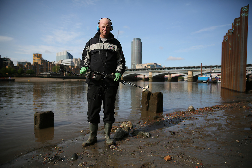 Mudlarker Matthew Goode poses for a portrait on the bank of the river Thames in London, Britain May 22, 2016. When the river Thames is at low tide, mudlarkers scour the shore for historical artefacts and remains from there City of London's ancient past. Finds can date back to Roman times to when the city was found up until more recent times. Anyone can walk along the river and look for finds, but the uses of metal detectors and digging is restricted. Mudlarkers need to be licences by the Port of London Authority. All find should be register with the Museum of London. REUTERS/Neil Hall