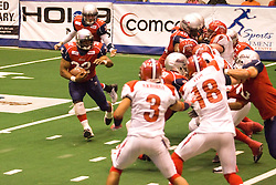 14 March 2009: Mitch Tanney hands off to Keith Brooks who looks to go around the right end. The Sioux Falls Storm were hosted by the Bloomington Extreme in the US Cellular Coliseum in downtown Bloomington Illinois.