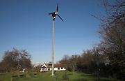 Single wind turbine for domestic electricty generation in the garden of a house, Wardspring Farm, near Saxmundham, Suffolk, England