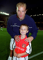 Dennis Bergkamp with the Arsenal mascot. Arsenal 3:2 FC Shakhar Donetsk, UEFA Champions League, Group B, 20/9/2000. Credit Colorsport / Stuart MacFarlane