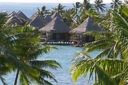 Overwater bungalows and palm trees at Tahiti International Hotel, Tahiti