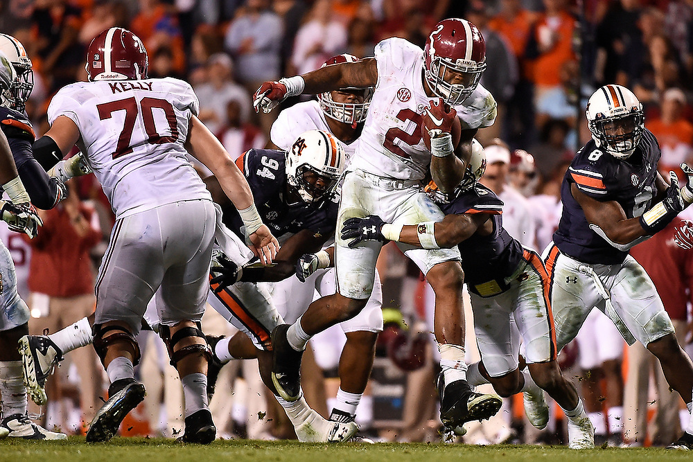 Alabama running back Derrick Henry (2) breaks the Auburn defenders' tackles. <br /> No. 2 Alabama Crimson Tide vs. Auburn Tigers at Jordan-Hare Stadium in Auburn, Ala. on Saturday, Nov. 28, 2015. <br /> Zach Bland/Auburn Athletics