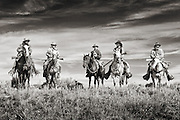 A gathering of mountain men along the ridge line  at a rendezvous in southern Wyoming.