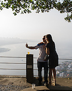 A couple take a selfie at the top of Morro da Urca, the halfway stop to the to pof Sugarloaf. Scenes from Rio de Janeiro on the day that Brazil drew 0-0 with Mexico. Photo by Andrew Tobin/Tobinators Ltd