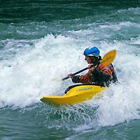 Nadege Luquet (MR) kayaks on the Kananaskis River, near Calgary, Alberta, Canada.