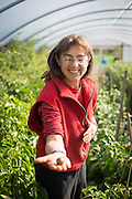 Portrait of Shari Sirkin in greenhouse.