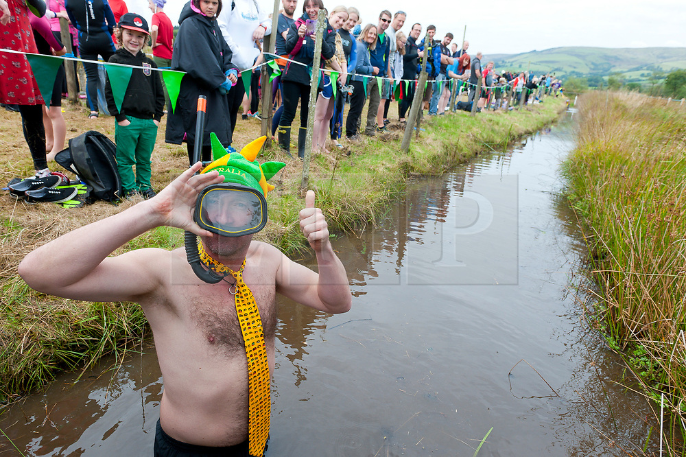 © Licensed to London News Pictures. 27/08/2017. Llanwrtyd Wells, Powys, Wales, UK. Australian truck driver Steve Kelly has travelled from Australia to do the Bog Snorkelling. The 32nd annual World Bog Snorkelling Championships, conceived over 30 years ago in a Welsh pub by landlord Gordon Green, are held at the Waen Rhydd Bog. Using unconventional swimming strokes, participants swim two lengths of a 55 metre trench cut through a peat bog wearing snorkel mask and flippers. Photo credit: Graham M. Lawrence/LNP