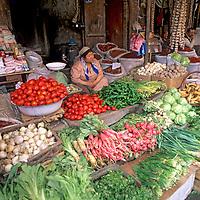 CHINA, Xinjiang Province. Uygur vegetable merchant in Kashgar Bazaar.