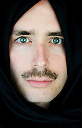 A portrait of a young Arab Man wearing a kaffiyeh Model Release Available