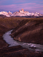 Sunrise light on Fitz Roy with Rio de La Vueltas flowing through a canyon in the foreground, Argentina