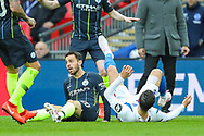 Brighton & Hove Albion forward Alireza Jahanbakhsh (16) is tackled by Manchester City midfielder Bernardo Silva (20) during the The FA Cup semi-final match between Manchester City and Brighton and Hove Albion at Wembley Stadium, London, England on 6 April 2019.