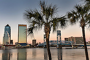 City skyline from the Southbank Riverwalk along the St. John's River at sunset in Jacksonville, Florida.