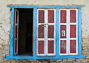 A red, white and blue colored door in a house in the Khumbu District, in Himalaya of eastern Nepal.