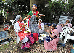 WATFORD HERTFORDSHIRE: Women relax after some of the 60thousand meals were handed out free to visitors. Over 55,000 pilgrims and guests visit the Largest Hindu Festival in Europe at Bhaktivedanta Manor Krishna Temple near Watford on Sunday 5th September to celebrate Janmashtami the birth of Lord Krishna. The Manor was donated to the Hare Krishna Movement in the early 1970s by former Beatle George Harrison. 03 SEPT 2010. STEPHEN SIMPSON ..