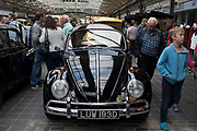 Black Volkswagen Beetle vintage car on show at a monthly meet up in Greenwich Market in London, England, United Kingdom.