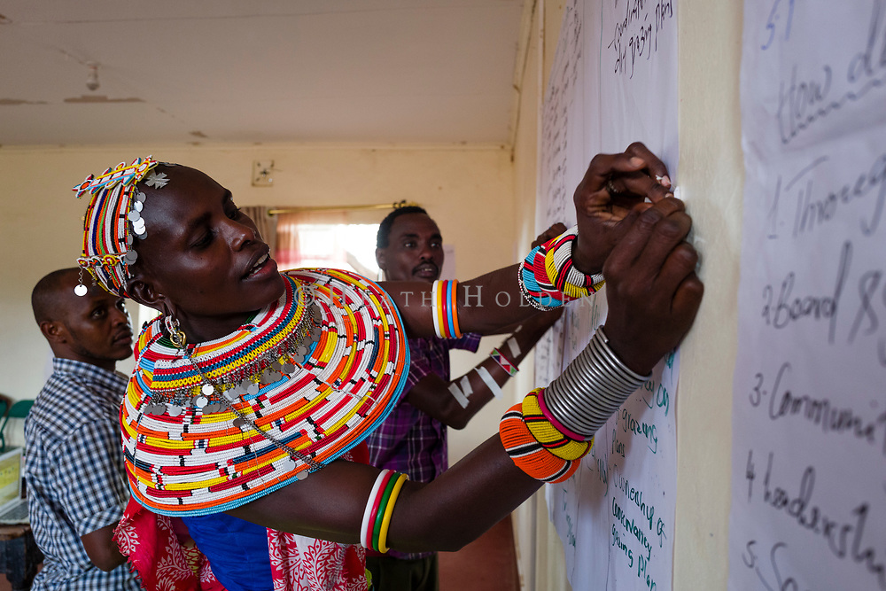 Samburu tribes attend a workshop on holistic land management, which aims to improve crop yields and protect habitat for wildlife.