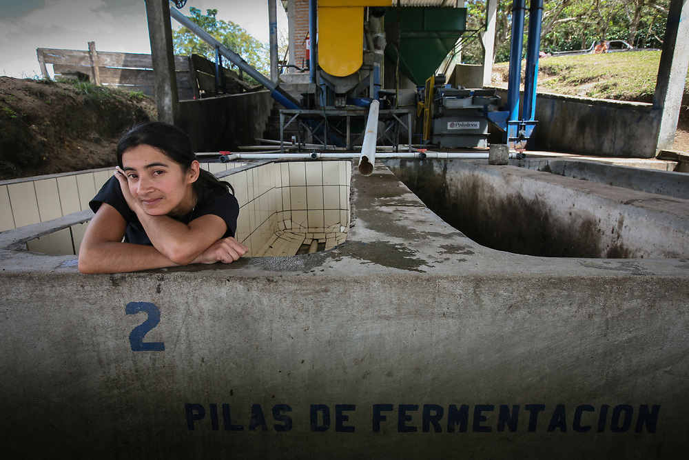 Berónica Gabarette at the fermentation tanks at the coffee mill. Cooperativa Agropecuaria de Producción Flor del Pino is a Fairtrade-certified producer based in Ocotepeque, Honduras.