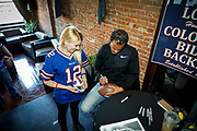 SHOT 12/10/17 12:37:46 PM - Former Buffalo Bills wide receiver and Hall of Fame player Andre Reed signs autographs and meets with fans at LoDo's Bar and Grill in Denver, Co. as the Buffalo Bills played the Indianapolis Colts that Sunday. Reed played wide receiver in the National Football League for 16 seasons, 15 with the Buffalo Bills and one with the Washington Redskins. (Photo by Marc Piscotty / © 2017)