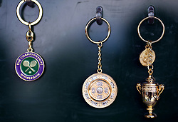 Wimbledon trophy keyrings for sale on day nine of the Wimbledon Championships at The All England Lawn Tennis and Croquet Club, Wimbledon.