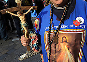 © Licensed to London News Pictures. 02/11/2011. London, UK. A woman who identifies herself as Sister Ruth holds a cross with a figure of Jesus. Occupy London protesters outside St Paul's Cathedral today, 2nd November 2011.  Photo credit : Stephen Simpson/LNP