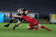 Olly Cracknell of the Ospreys (l) is stopped by Will Boyde of the Scarlets.  Guinness Pro14 rugby match, Ospreys v Scarlets at the Liberty Stadium in Swansea, South Wales on Saturday 7th October 2017.<br /> pic by Andrew Orchard, Andrew Orchard sports photography.