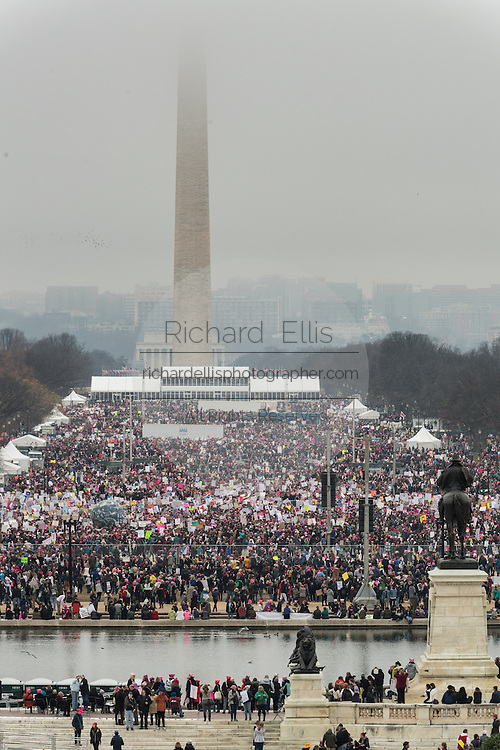 Hundreds of thousands of demonstrators gather on the National Mall during the Women's March on Washington in protest to President Donald Trump January 21, 2017 in Washington, DC. More than 500,000 people crammed the National Mall in a peaceful and festival rally in a rebuke of the new president.