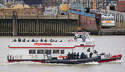 © Licensed to London News Pictures. 19/03/2017. London, UK. Anti-terror Police board a tourist boat, taken hostage by people playing armed terrorists, in an ant-terror training exercise takes place on The River Thames in  London. It is the first time that an exercise of this type has taken place on the river. Photo credit: Ben Cawthra/LNP