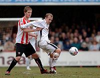 Photo: Daniel Hambury.<br />Brentford v Doncaster Rovers. Coca Cola League 1. 25/03/2006.<br />Brentford's Michael Turner and Doncaster's Neil Roberts battle.