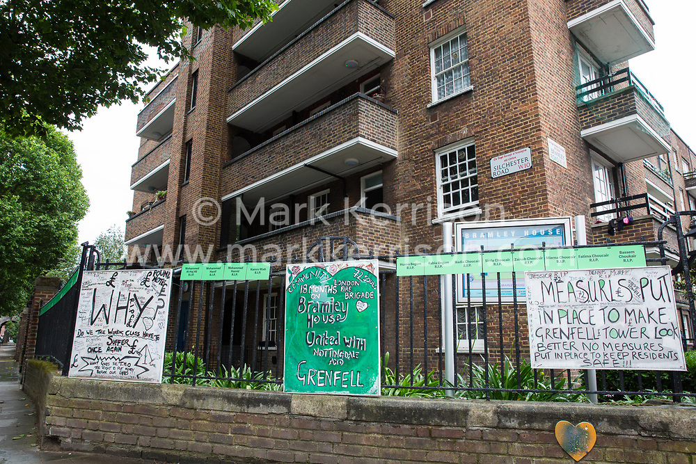 London, UK. 13 June, 2019. Signs close to the Grenfell Tower in North Kensington. Tomorrow, the Grenfell community will mark the second anniversary of the Grenfell Tower fire on 14th June 2017 in which 72 people died and over 70 were injured. Two years on, some family members remain in temporary accommodation and many are still traumatised. Phase 2 of the Grenfell Inquiry will begin in 2020, with criminal investigation findings expected to be sent to the Crown Prosecution Service in 2021.