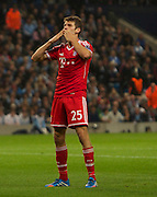 02.10.2013 Manchester, England.  Bayern Munich's Thomas Muller celebrates after he makes it 2-0 during the Group D UEFA Champions League game between, Manchester City and Bayern Munich from the Etihad Stadium.