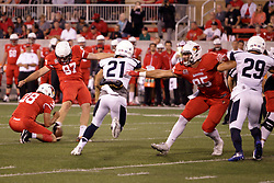 02 September 2017:   Zach Breen hold the ball for the point after kick by Sean Slattery as Tylor Petkovich holds off both Mike Cerone and Jacob Balder during the Butler Bulldogs at  Illinois State Redbirds Football game at Hancock Stadium in Normal IL (Photo by Alan Look)