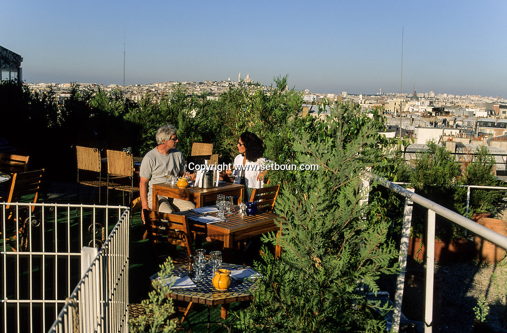 France Paris. panoramic view on Paris and the sacre coeur from the terrace of the cafe bar, the Golf club