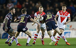 St Helens' Luke Thompson is tackled by Leeds Rhinos Brad Singleton during the Betfred Super League match at The Totally Wicked Stadium, St Helens.
