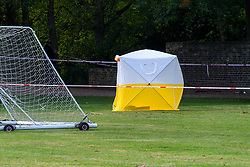 © Licensed to London News Pictures. 13/10/2021. London, UK. A police forensic tent on Craneford Way Playing Fields following the fatal stabbing of a teenager. Police were called at 16:45BST on Tuesday, 12 October to reports of a stabbing in Craneford Way, Twickenham. Metropolitan Police Service (MPS) and London Ambulance Service (LAS) attended. They found an 18-year-old man who is believed to have sustained knife wounds. He was taken by LAS to an outer London hospital where he was pronounced dead at 17:54BST. Photo credit: Peter Manning/LNP