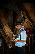 Krakow, Poland - September 3, 2016: Zbigniew Ojczyk plays the trumpet from atop the tower of Saint Mary's Church in Krakow, Poland. Every hour on the hour a trumpeter plays Hejnał Mariacki (also called the Kraków Anthem) a traditional, five-note Polish anthem.