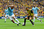 Vincent Kompany (4) of Manchester City challenges Roberto Pereyra (37) of Watfordduring the The FA Cup Final match between Manchester City and Watford at Wembley Stadium, London, England on 18 May 2019.