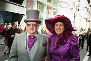 A couple in vintage attire, including a top hat.