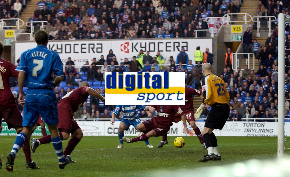 Photo: Daniel Hambury.<br />Reading v Brighton & Hove Albion. Coca Cola Championship. 10/12/2005.<br />A Glen Little cross is dirvired into his own net by Brighton's Charlie Oatway (centre).