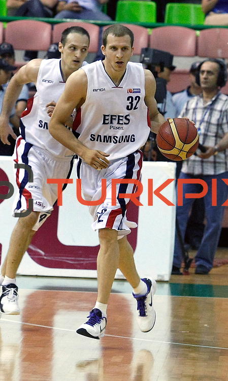 Efes Pilsen's Sinan GULER (F), Igor RAKOCEVIC (B) during their Turkish Basketball league Play Off Final fifth leg match Efes Pilsen between Fenerbahce Ulker at the Ayhan Sahenk Arena in Istanbul Turkey on Sunday 30 May 2010. Photo by Aykut AKICI/TURKPIX
