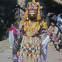 NEPAL, HIMALAYA. Masked Sherpa dancer at annual Tibetan Buddhist Mani Rimdu festival at Tengboche Monastery, Khumbu region.