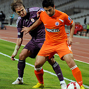 Istanbul BBSpor's Ali GUZELDAL (R) and Galatasaray's Caner ERKIN (L) during their Turkish soccer superleague match Istanbul BBSpor between Galatasaray at the Ataturk Olympic stadium in Istanbul Turkey on Saturday 01 May 2010. Photo by TURKPIX