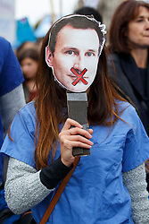 **Junior doctors in England have today (19/11/2015) voted in favour of strike action in a dispute over Government's proposed changes to work and pay contracts** FILE PICTURE © Licensed to London News Pictures. 17/10/2015. London, UK. A junior doctor holding a Jeremy Hunt mask on her face whilst junior doctors and NHS staff protesting against the health service cuts and the proposed contract changes offered by the government outside Parliament in London on Saturday, 17 October 2015. Photo credit: Tolga Akmen/LNP