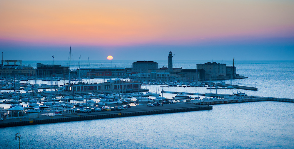 Panoramic view of the marina in Trieste, Italy at sunset