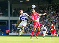 Photo: © Andrew Fosker / Richard Lane Photography - Barnsley's Hugo Colace out jumps Wayne Routledge (L)  Queens Park Rangers v Barnsley - Coca-Cola Championship - 26/09/09 Loftus Road - London -  UK - All Rights Reserved
