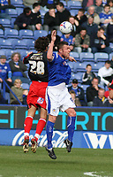 Photo: Mark Stephenson.<br />Leicester City v Queens Park Rangers. Coca Cola Championship. 17/03/2007. Leicester's Mark Yates wins the header