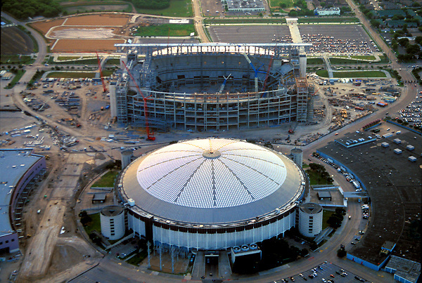 Stock photo of an aerial view of Houston's Astrodome and the construction of Reliant Stadium
