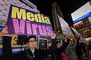 """Anti-mask protesters in front of Shibuya Station, Tokyo, Japan. Saturday November 21st 2020. Many protestor support YouTuber and leader of the Popular Sovereignty Party Masayuki Hiratsuka, who unsuccessful campaigned in the July Tokyo Gubernatorial Election. withnthe slogan """"Coronavirus is just a cold"""". The group hold """"cluster festivals"""" on trains and around Tokyo oposing any government action to combat the Pandemic. Photo Damon Coulter/AFLO"""