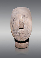 Large Cycladic Canonical type, Spedos variety female figurine head. Early Cycladic Period II from Syros phase , (2800-2300 BC). Museum of Cycladic Art Athens, cat no 284.  Against Grey Background.